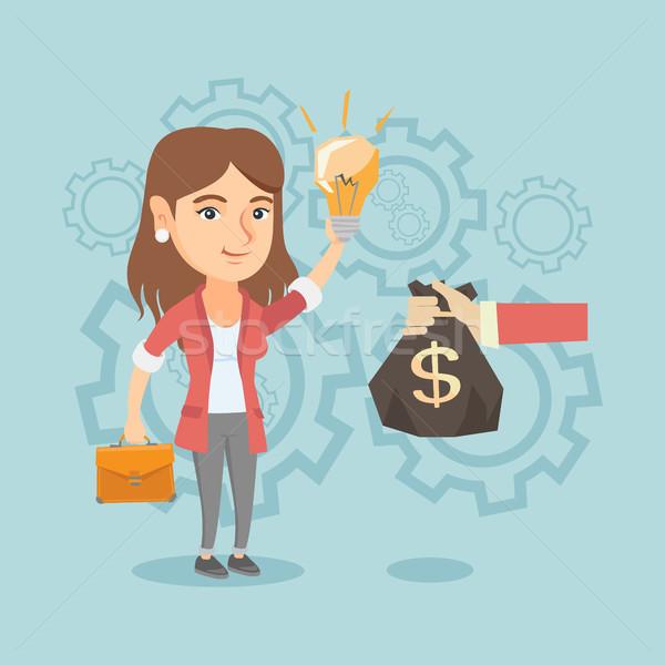 Caucasian businesswoman exchanging idea for money. Stock photo © RAStudio