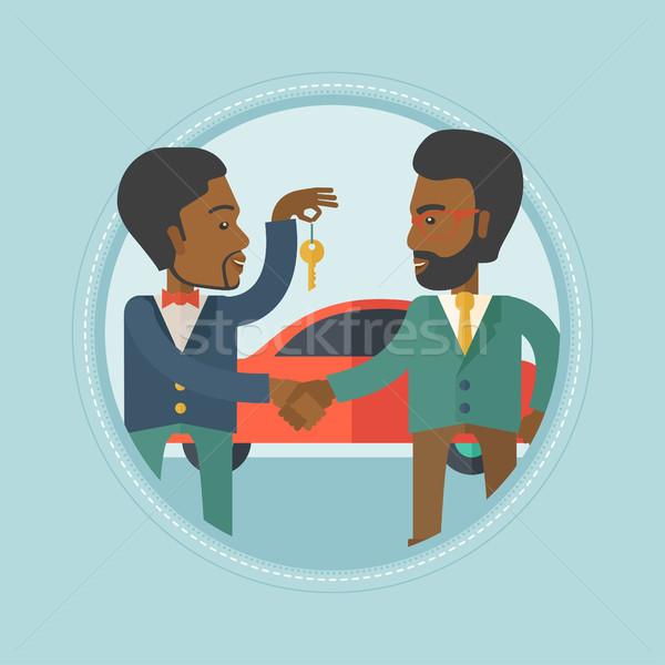 Car salesman giving key to new owner. Stock photo © RAStudio