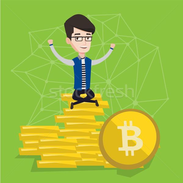 Young businessman sitting on gold bitcoin coins. Stock photo © RAStudio