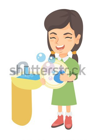 Little african girl washing dishes in the sink. Stock photo © RAStudio