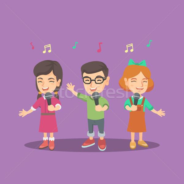 Ninos coro cantando canción grupo alegre Foto stock © RAStudio