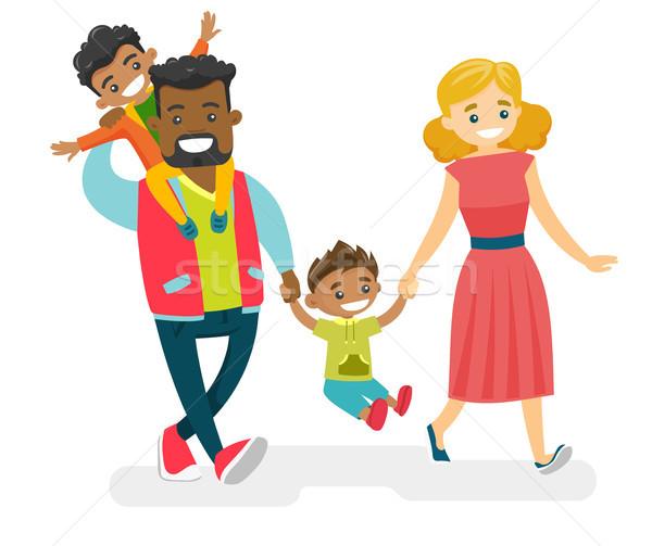 Happy multiracial family walking and having fun. Stock photo © RAStudio