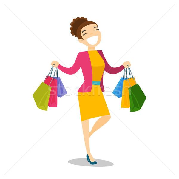Boldog kaukázusi fehér nő hordoz bevásárlótáskák Stock fotó © RAStudio