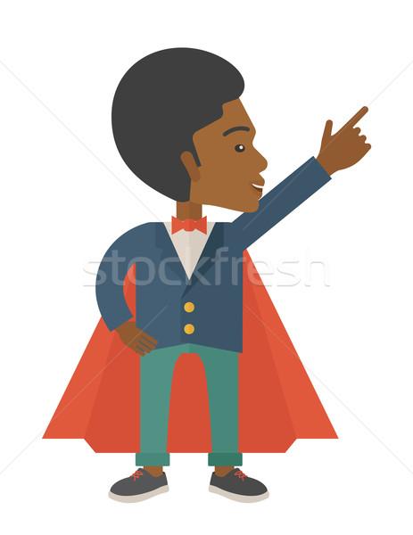 Hero african man pointing up high to the sky.  Stock photo © RAStudio