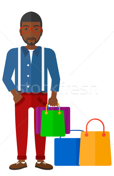 Buyer with shopping bags. Stock photo © RAStudio