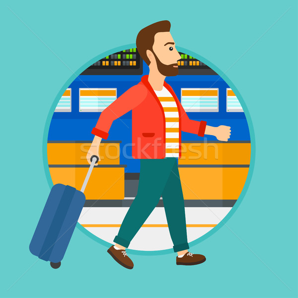 Man walking with suitcase at the airport. Stock photo © RAStudio