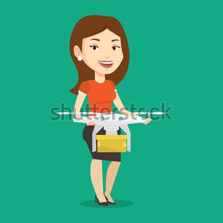 Woman controlling delivery drone with post package Stock photo © RAStudio