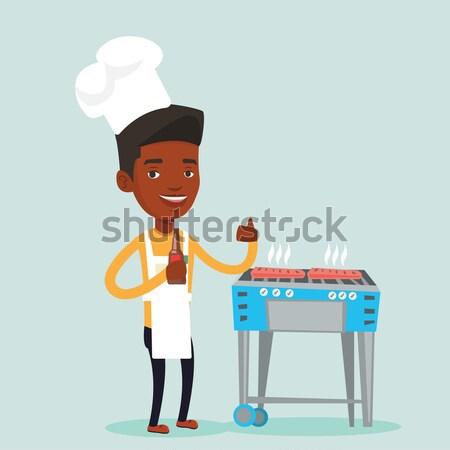 Man cooking steak on gas barbecue grill. Stock photo © RAStudio