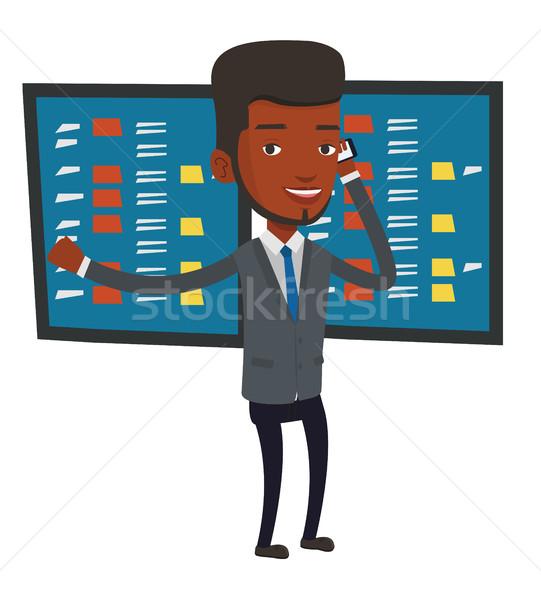 Börse aufgeregt Geschäftsmann sprechen Handy Display Stock foto © RAStudio