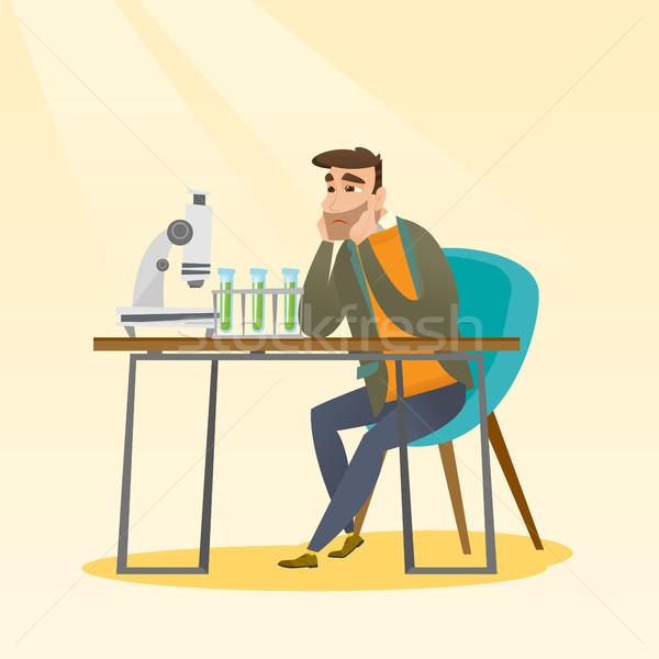 Student working at laboratory class. Stock photo © RAStudio
