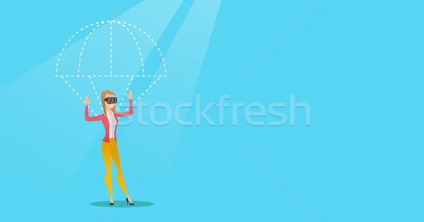 Young woman in vr headset flying with parachute. Stock photo © RAStudio