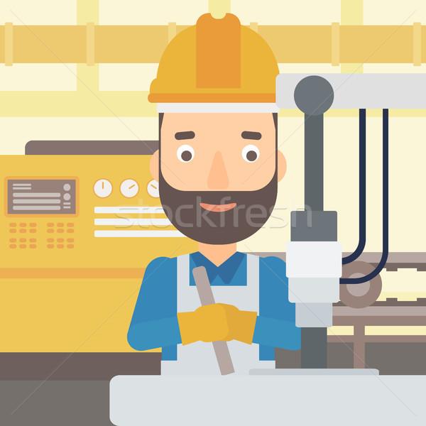Man working with industrial equipment. Stock photo © RAStudio