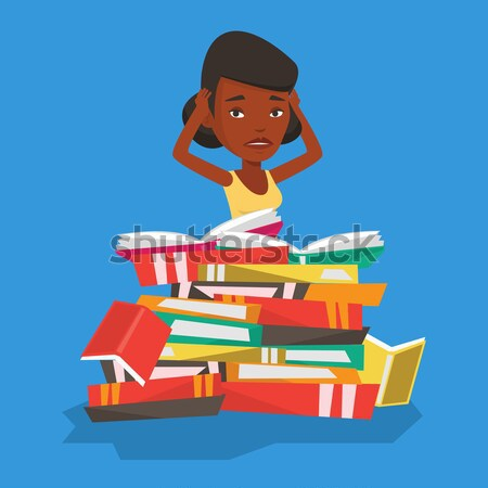 African student sitting in a huge pile of books. Stock photo © RAStudio