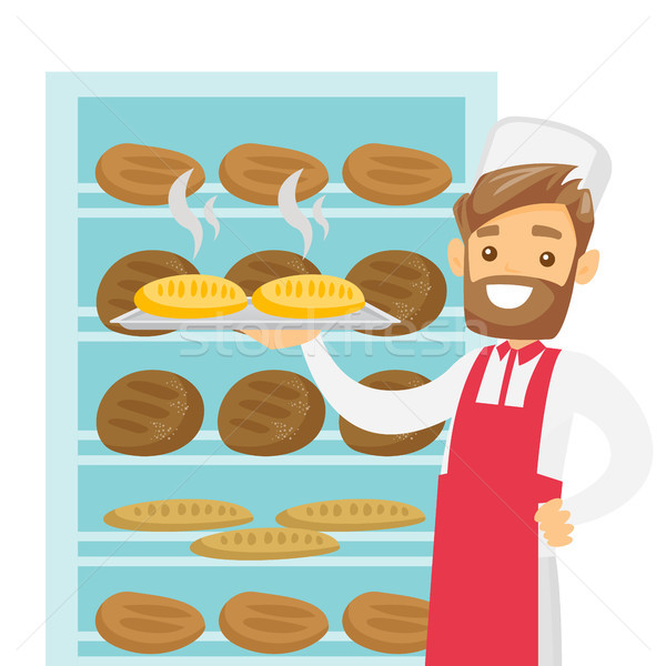 Caucasian white baker holding tray with bread. Stock photo © RAStudio