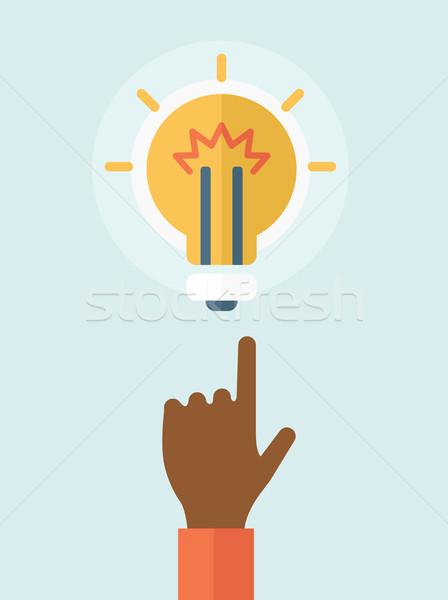Finger pointer and light bulb. Stock photo © RAStudio