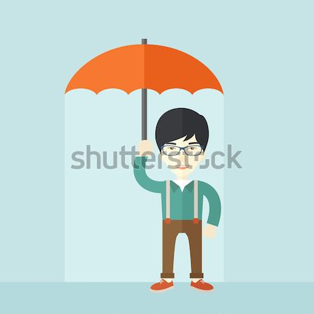 Chinese businessman with umbrella as protection. Stock photo © RAStudio