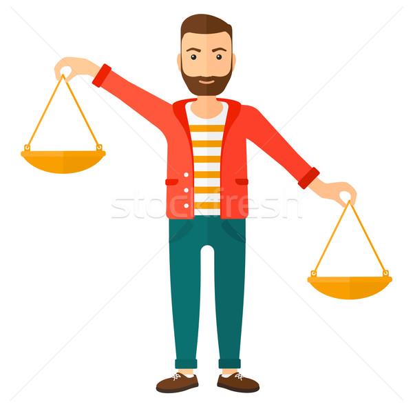 Businessman with scales. Stock photo © RAStudio