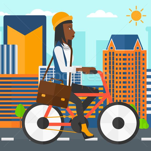 Mulher ciclismo trabalhar pasta cidade vetor Foto stock © RAStudio