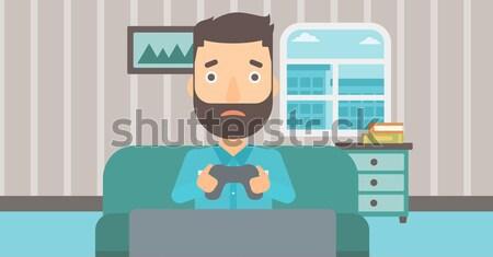 Addicted video gamer. Stock photo © RAStudio