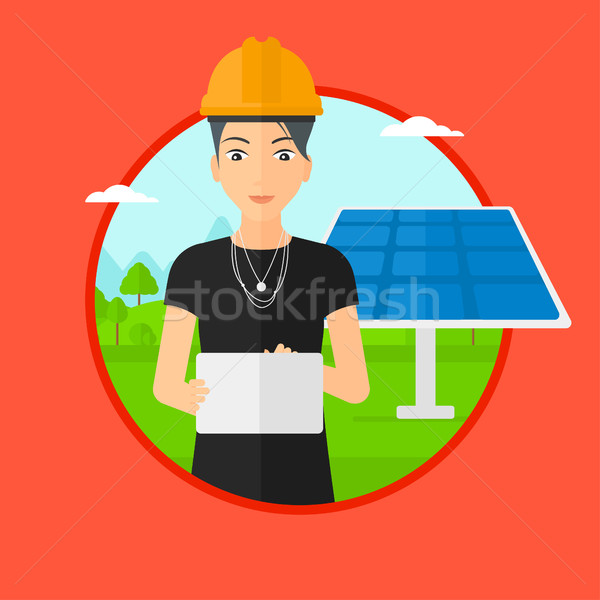 Female worker of solar power plant. Stock photo © RAStudio
