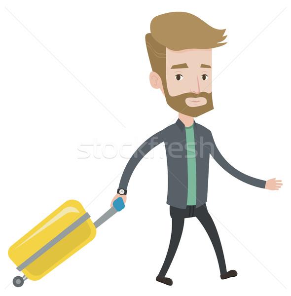 Caminando maleta jóvenes caucásico hombre Foto stock © RAStudio