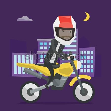Homem equitação motocicleta noite capacete cidade Foto stock © RAStudio
