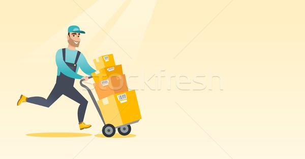 Levering postbode karton dozen kaukasisch jonge Stockfoto © RAStudio