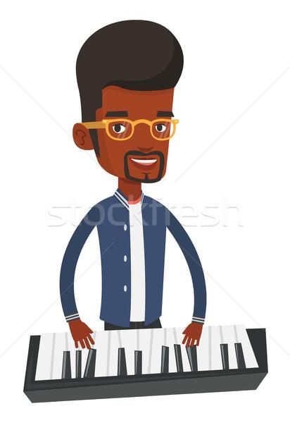 Férfi játszik zongora férfi zongorista fiatal Stock fotó © RAStudio