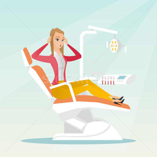 Afraid woman sitting in the dental chair. Stock photo © RAStudio