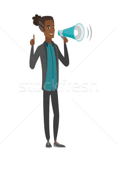 Fiatal afrikai üzletember beszél hangfal készít Stock fotó © RAStudio