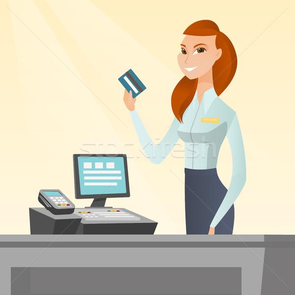 白人 キャッシャー クレジットカード 笑みを浮かべて 立って ストックフォト © RAStudio