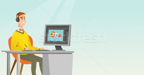 Caucasian designer using digital graphics tablet. Stock photo © RAStudio