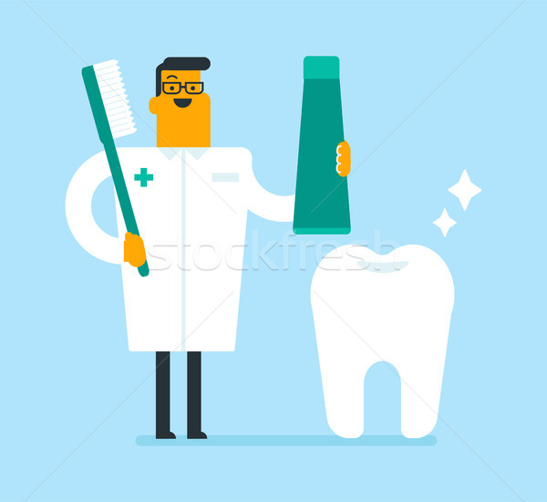 Dentist holding toothpaste and a toothbrush. Stock photo © RAStudio