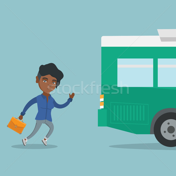 Young african latecomer woman running for the bus. Stock photo © RAStudio