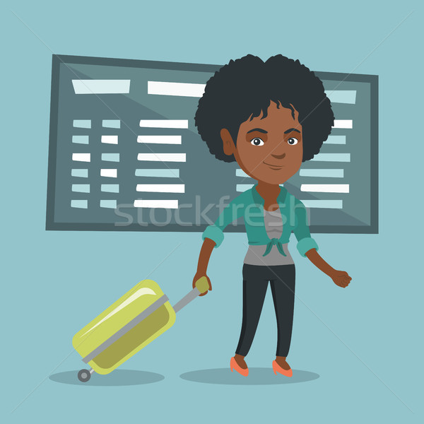 African woman walking with suitcase at airport. Stock photo © RAStudio