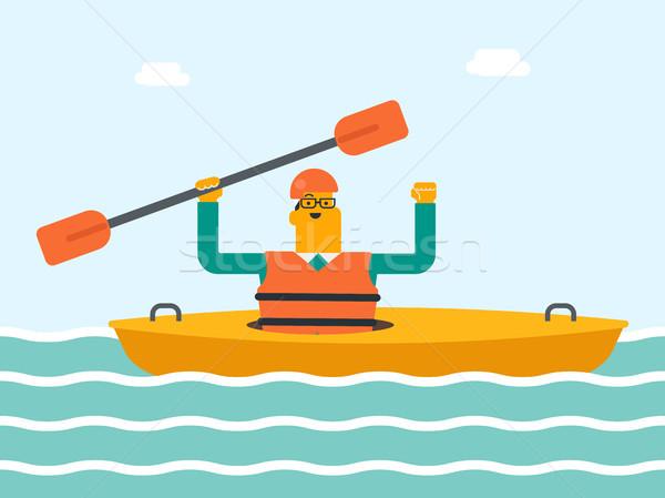 Young caucasian white man riding a kayak. Stock photo © RAStudio