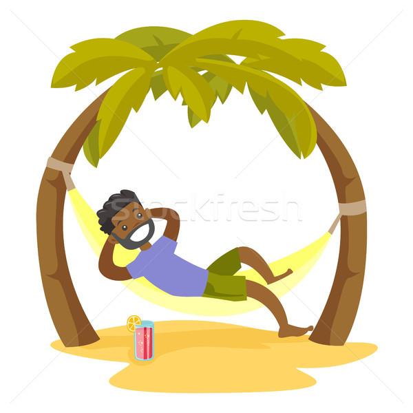человека гамак пляж молодые счастливым расслабляющая Сток-фото © RAStudio