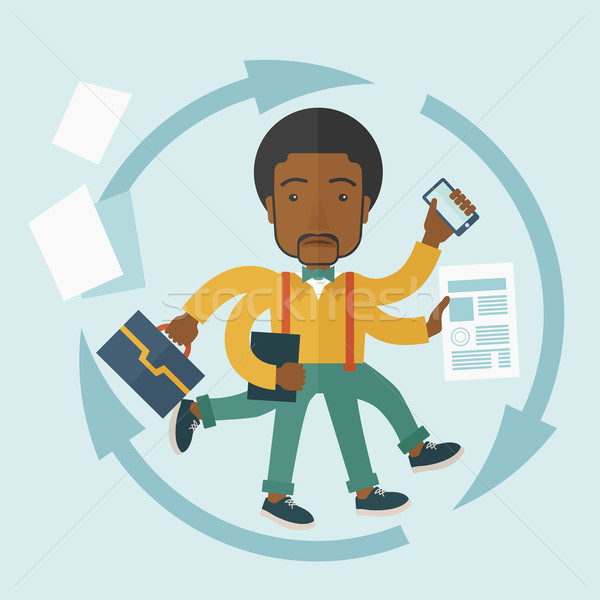 Black guy with multitasking job. Stock photo © RAStudio