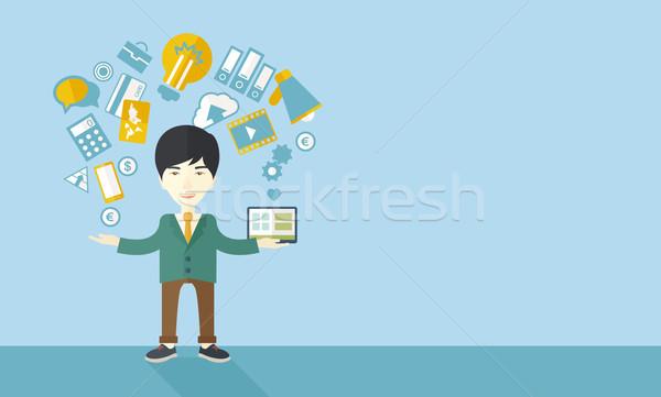 Happy chinese self employed. Stock photo © RAStudio