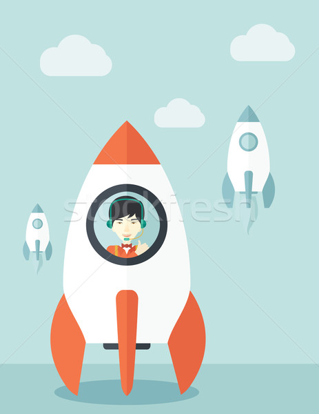 Young asian guy in side the rocket. Stock photo © RAStudio