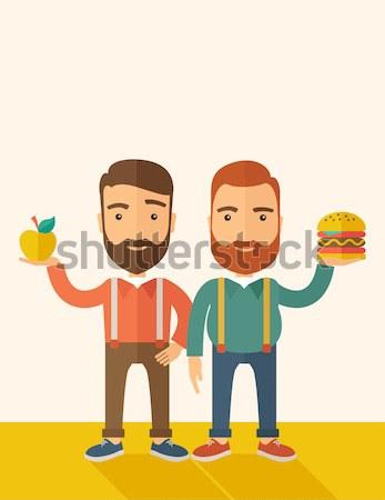 Erkekler ayakta hamburger elma adam Stok fotoğraf © RAStudio