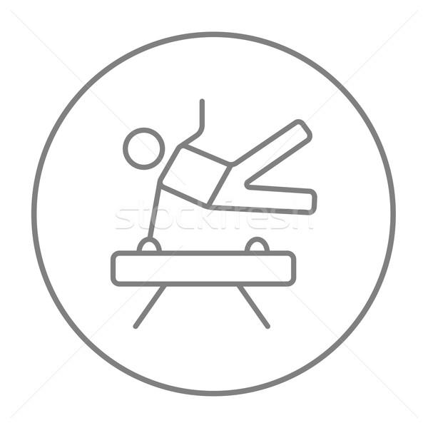 Gymnast exercising on pommel horse line icon. Stock photo © RAStudio