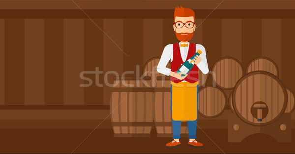 Waiter holding bottle of wine. Stock photo © RAStudio