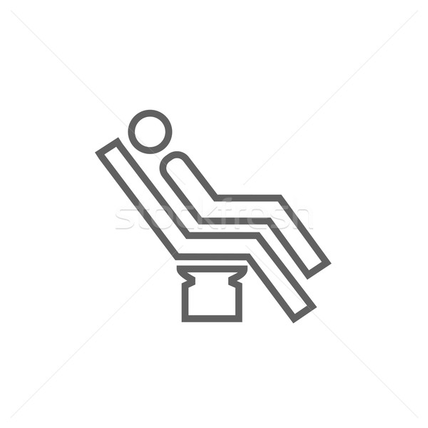 Man sitting on dental chair line icon. Stock photo © RAStudio