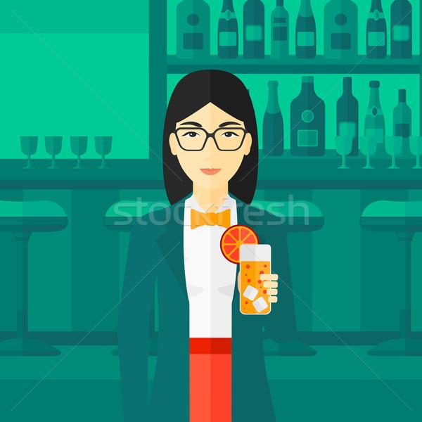 Woman holding glass of juice. Stock photo © RAStudio