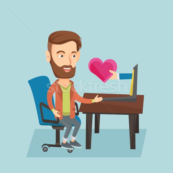 Fiatalember randizás online laptopot használ kaukázusi hipszter Stock fotó © RAStudio
