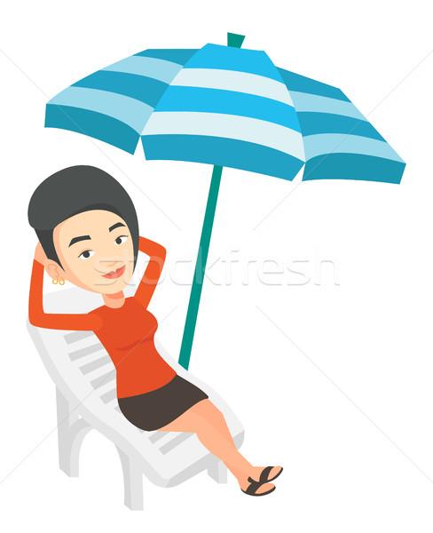Kobieta relaks leżak posiedzenia wakacje Zdjęcia stock © RAStudio