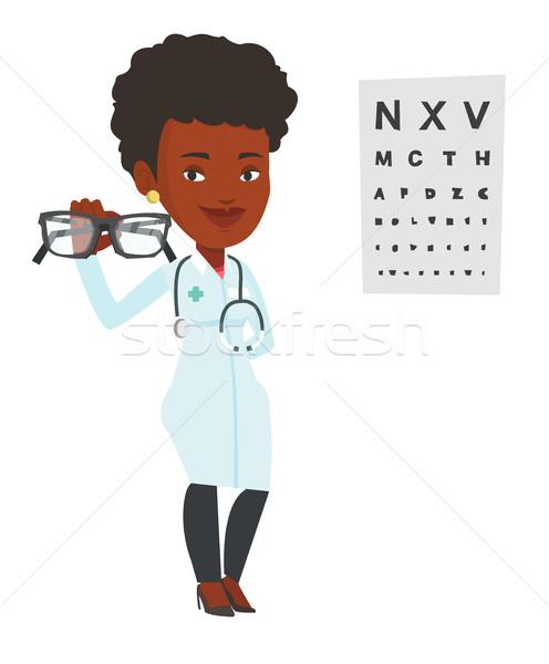Profi szemorvos tart szemüveg szemüveg szem Stock fotó © RAStudio