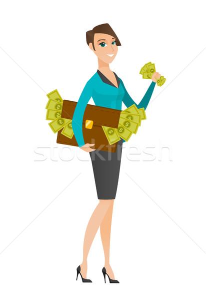 Zakenvrouw aktetas vol geld permanente economisch Stockfoto © RAStudio