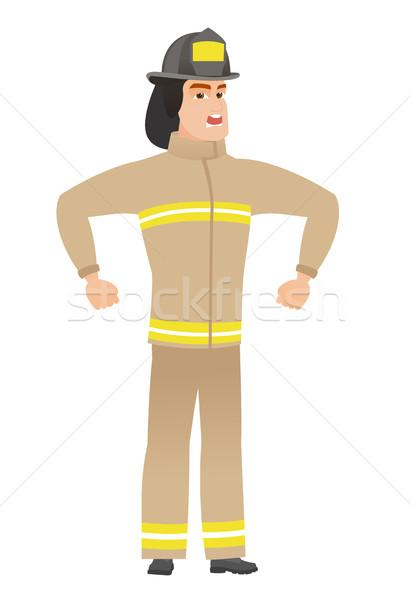 Jóvenes caucásico enojado bombero gritando uniforme Foto stock © RAStudio